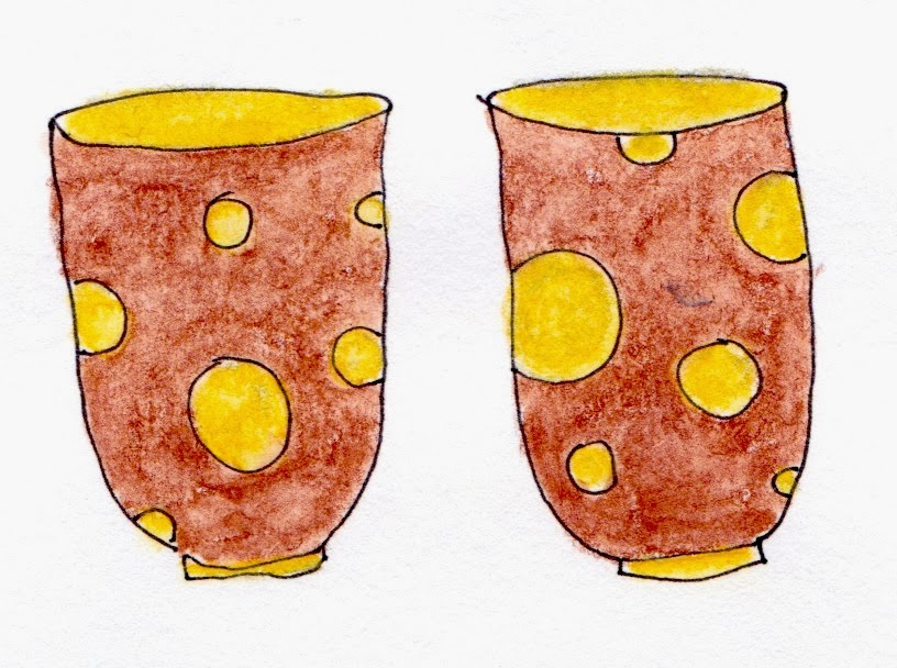 Red handle-less cups with yellow spots